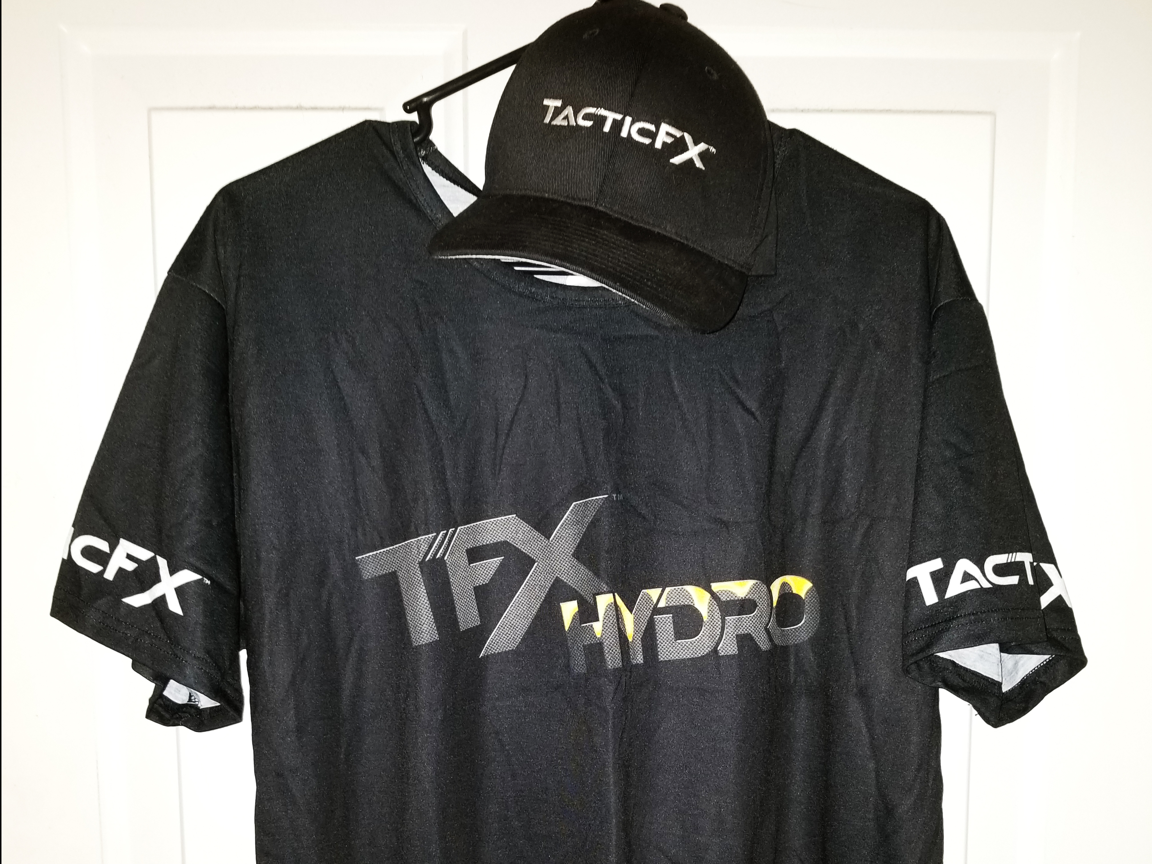 TacticFX Branded clothing hanging on a wall.